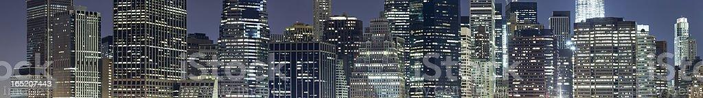 Lower Manhattan skyline at night panoramic stock photo