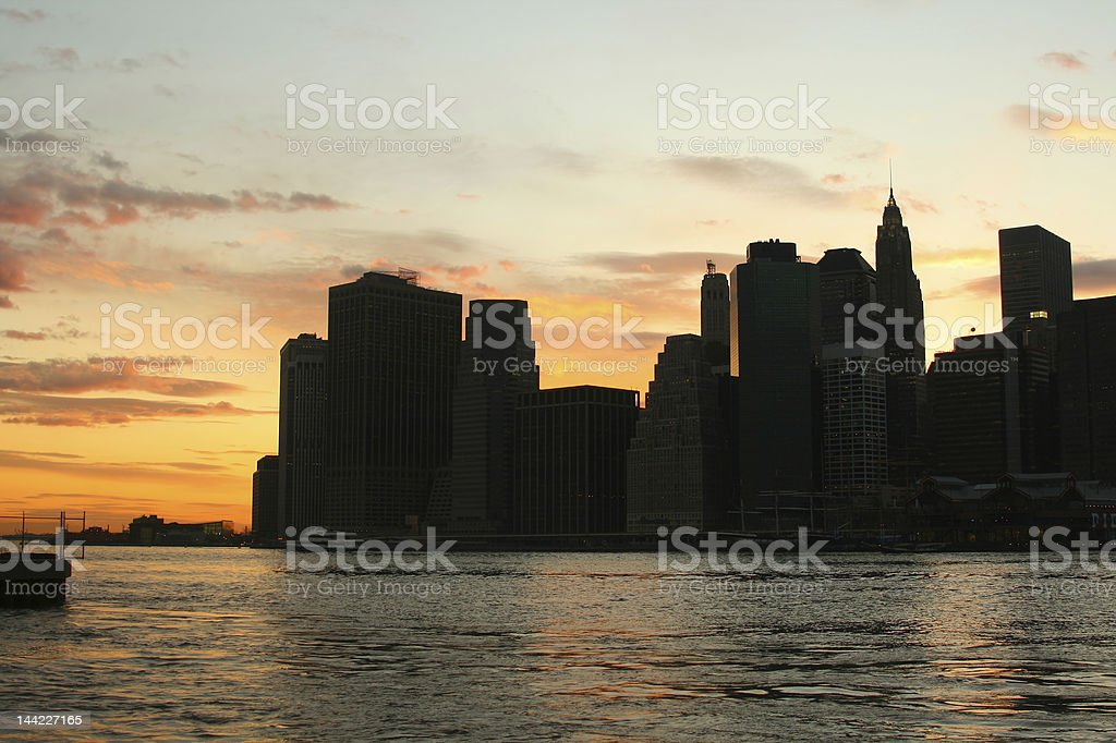 Lower Manhattan skyline At Sunset, NYC royalty-free stock photo