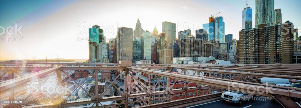 Lower Manhattan skyline from Brooklyn bridge panorama at sunset stock photo
