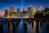 Lower Manhattan skyline at dusk from Brooklyn Bridge Park, Brooklyn, New York, USA