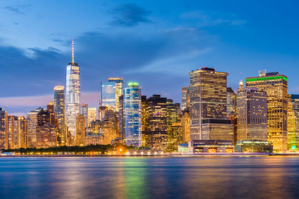 Lower Manhattan Skyline from New York Bay New York, New York, USA skyline on the bay at twilight. lower manhattan stock pictures, royalty-free photos & images