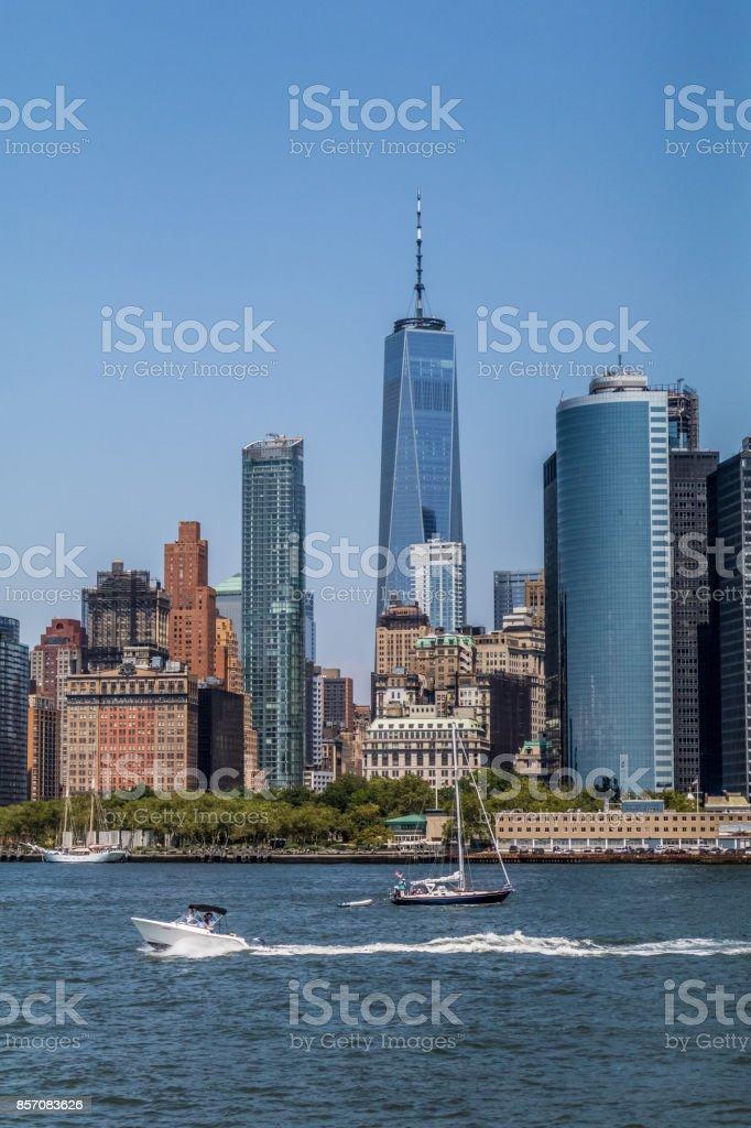 lower manhattan skyline with boat stock photo
