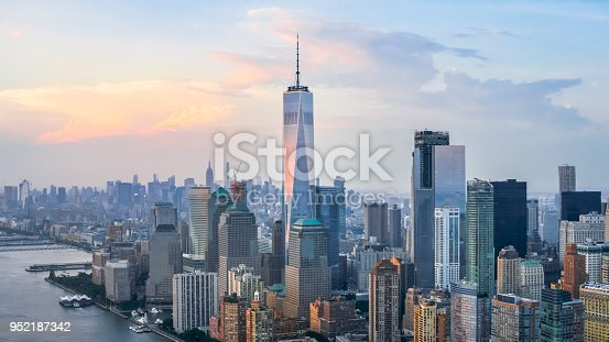Aerial shot of the Lower Manhattan and the Freedom Tower reflecting the clouds. Shot in USA.