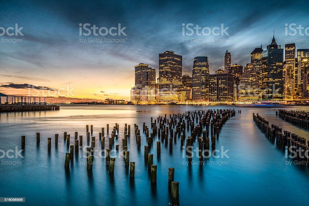Lower Manhattan with sunset in New York City stock photo