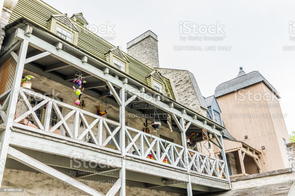 Lower old town street with apartment building and balcony decorated stock photo