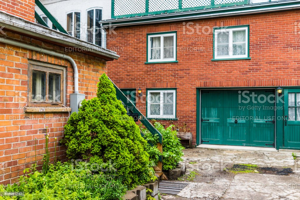Lower old town street with residential brick house and entrance stock photo