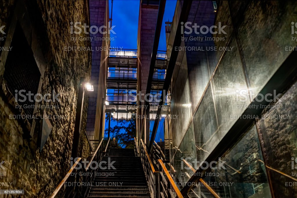 Lower old town street with stairs steps to go up in la place Royale on rue Notre-Dame stock photo