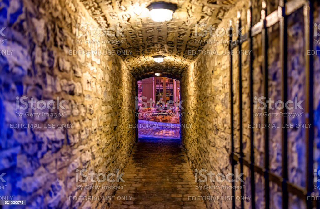 Lower old town with cobblestone street narrow alley Passage De La Batterie with light lamps at night twilight stock photo