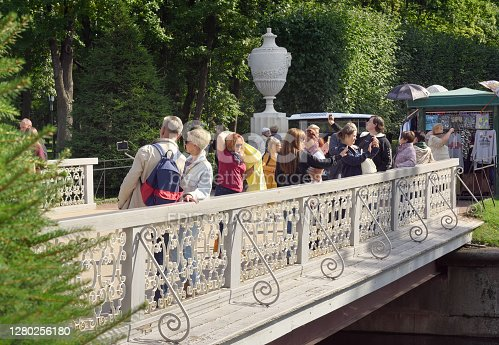 Peterhof, Saint Petersburg, Russia - 09.01.2020: Tourists take photos on a Sunny day on the Maryinsky bridge over the Samson canal