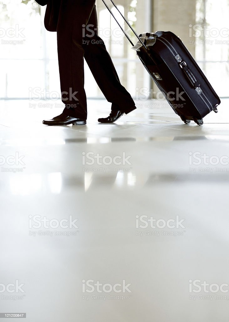 Lower section of a business man walking with travel bag royalty-free stock photo