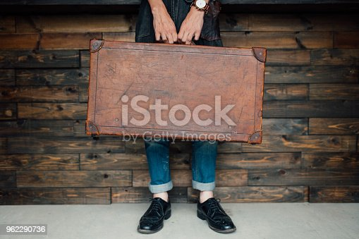 Lower section of a man holding a leather case, with copy space. Okayama, Japan.