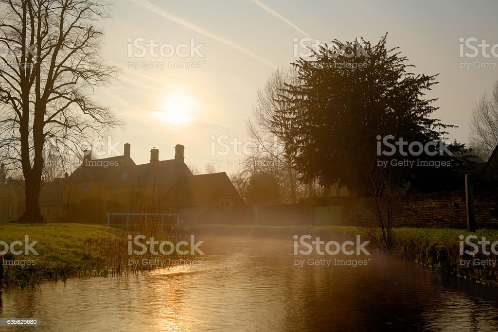 Lower Slaughter village river on a foggy January Morning stock photo