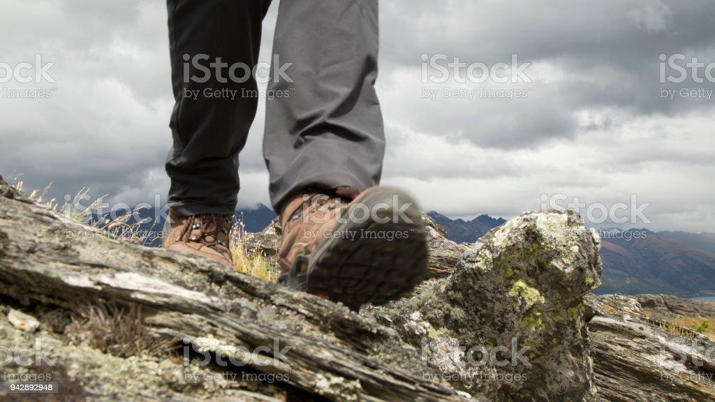 Lower torso of hiker on summit ridge stock photo