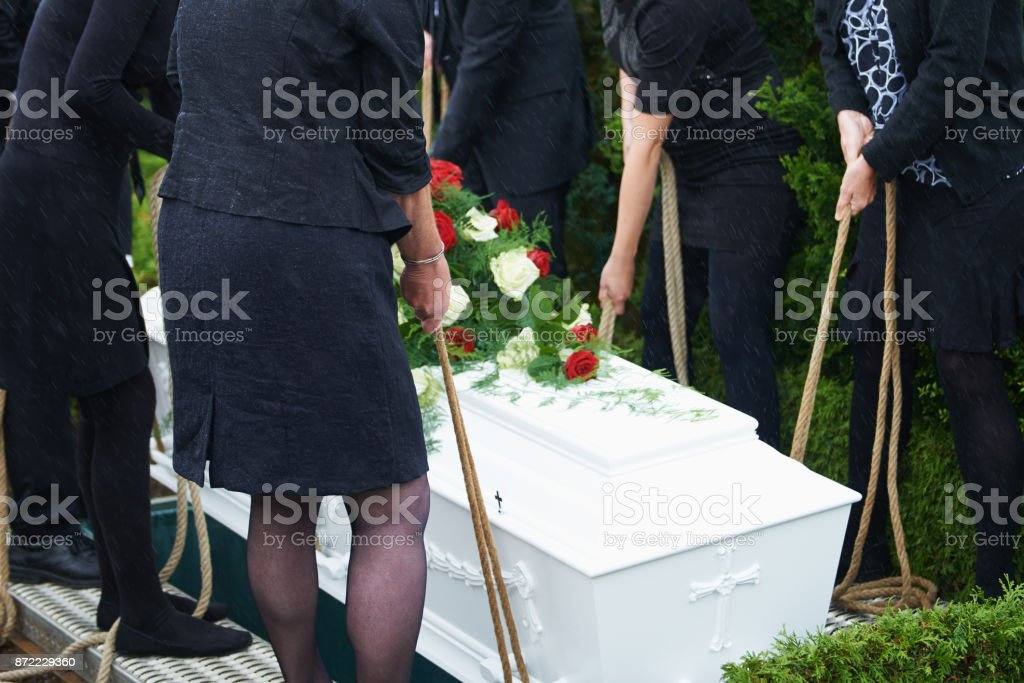 Lowering coffin stock photo
