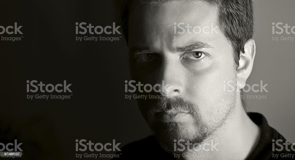 Low-key portrait of attractive young man royalty-free stock photo