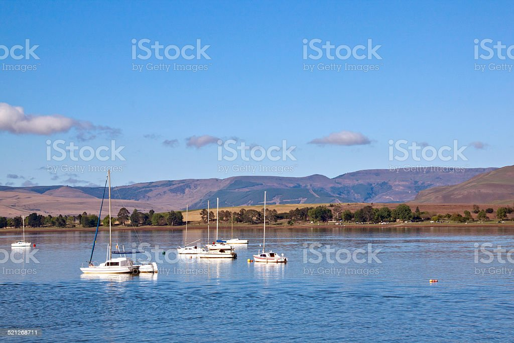 Low-lying Clouds on the Mountains and Yachts stock photo