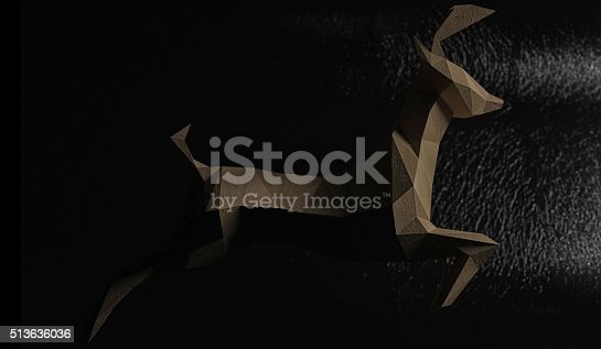 istock Lowpoly paper deer running toward the light. 513636036