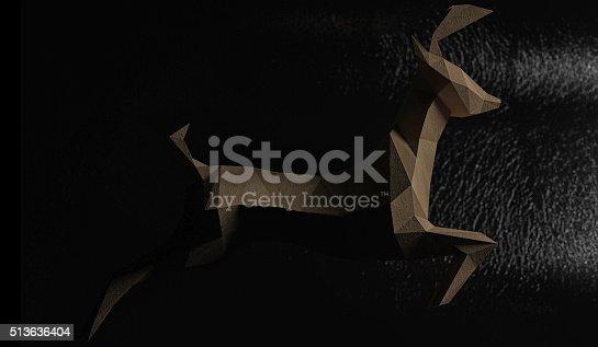 istock Lowpoly paper deer running toward the light. 513636404