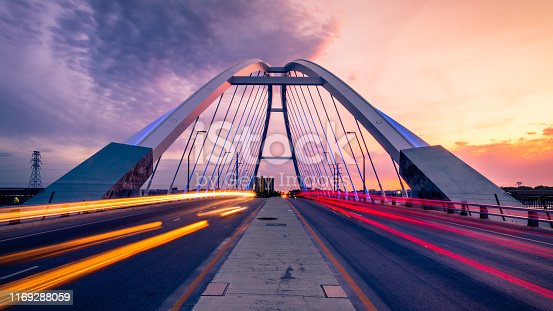 car trails at lowry bridge in minneapolis at sunset