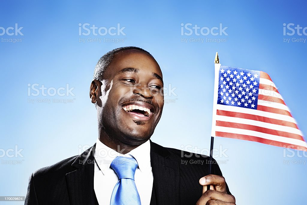 Loyal American smiles at the Stars & Stripes royalty-free stock photo