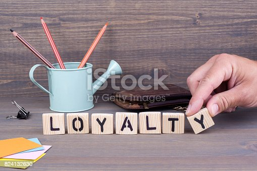 874270826istockphoto Loyalty. Wooden letters on dark background 824132630