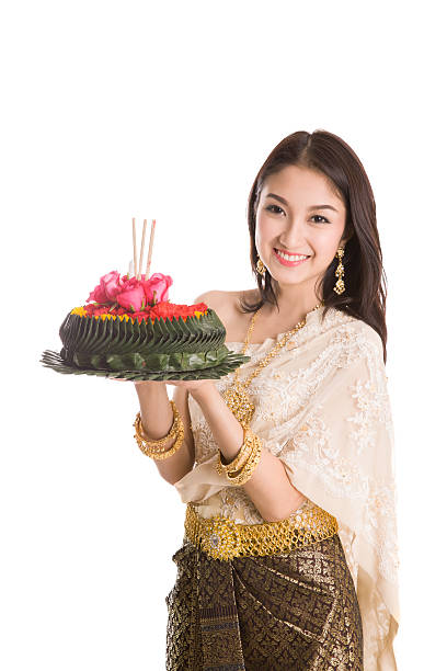 loykratong tradition, thai woman hold kratong - kratong stock photos and pictures