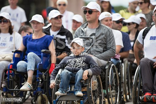 Belarus, the city of Gimel, July 03, 2019. Youth Festival.People in wheelchairs on a city street