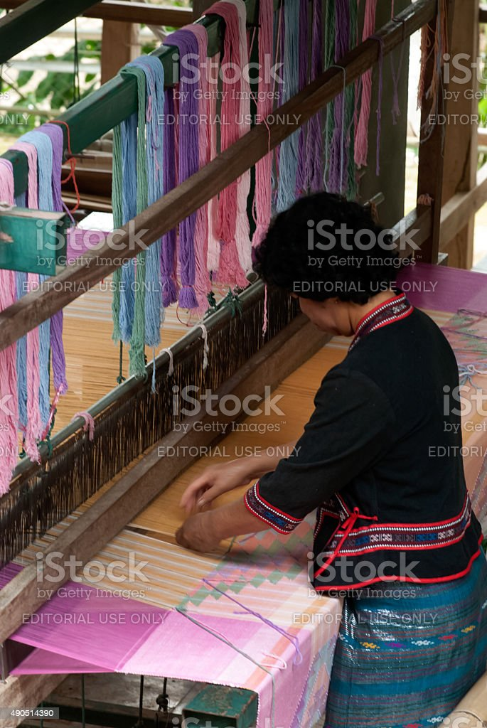 Lua Hill Tribe minority is weaving with loom in Thailand. stock photo