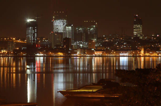 luanda at night - angola stock photos and pictures