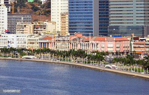 Luanda, Angola: the corniche - panorama of the waterfront avenue, Avenida Marginal / 4 de Fevereiro - colonial architecture survives under the shadow of the modern high-rise buildings - Luanda Bay, Atlantic Ocean - Ingombota (multiple small logos, compatible with Getty guidelines, article 1736)