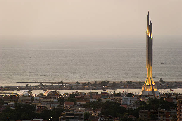 luanda panorama at sunset with agostinho neto mausoleum - angola stock photos and pictures