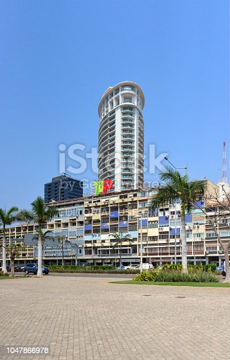 Luanda, Angola: downtown offices of TAP Air Portugal, the flag carrier airline of Portugal, a member of the Star Alliance and TAAG Angola Airlines - colonial building on Avenida Marginal, 4 de Fevereiro with TAP sign - in the background the Ambiente Tower and Baía Building, to the left two building of the Agostinho Neto University, the Faculties of Science and Economics