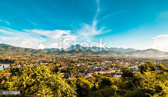 View of the town of Luang Prabang in Laos. The rich mountains of the province can be seen in the background.