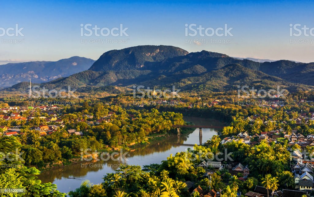 Luang Prabang, Laos, Southeast Asia: Landscape view over the city in the sunset lights from Mount Phousi royalty-free stock photo