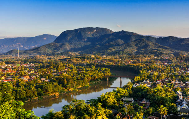 luang prabang, laos, southeast asia: landscape view over the city in the sunset lights from mount phousi - mekong river stock pictures, royalty-free photos & images