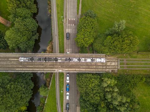 Luas tram over a rail bridge in Dublin, Ireland.