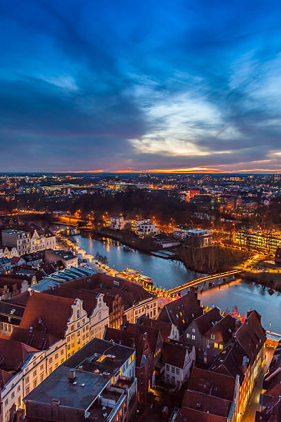 """Lubeck Germany by night Lubeck, Germany - december 29, 2012: A night view on the German town of Lubeck. Lubeck, """"the Queen of Hanseatic League"""", is on the UNNESCO world heritage list. duitsland stock pictures, royalty-free photos & images"""