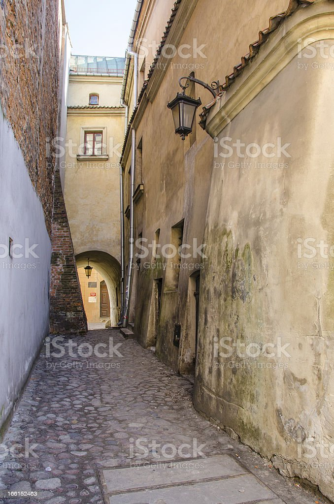 Lublin, Poland - alley and tenement houses in Old Town royalty-free stock photo