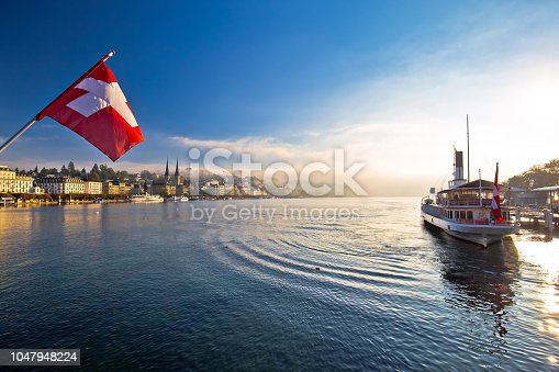 istock Lucern lake and town waterfront in morning mystic fog view, famous destination in Switzerland 1047948224