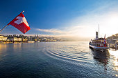 Lucern lake and town waterfront in morning mystic fog view, famous destination in Switzerland