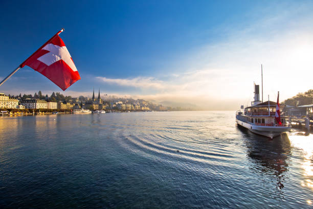 Lucern lake and town waterfront in morning mystic fog view, famous destination in Switzerland Lucern lake and town waterfront in morning mystic fog view, famous destination in Switzerland switzerland stock pictures, royalty-free photos & images