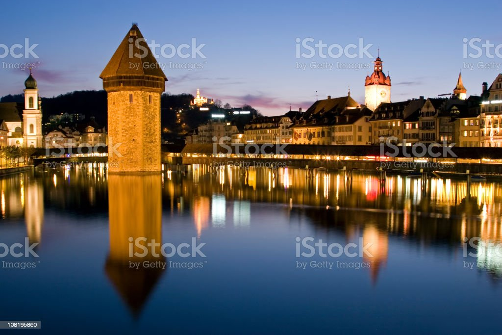 Lucerne City Skyline, Chapel Bridge Reflected on Water at Dusk royalty-free stock photo