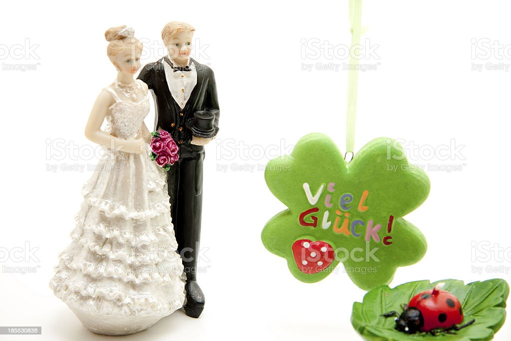 Luck cloverleaf and bride pair with ladybug royalty-free stock photo