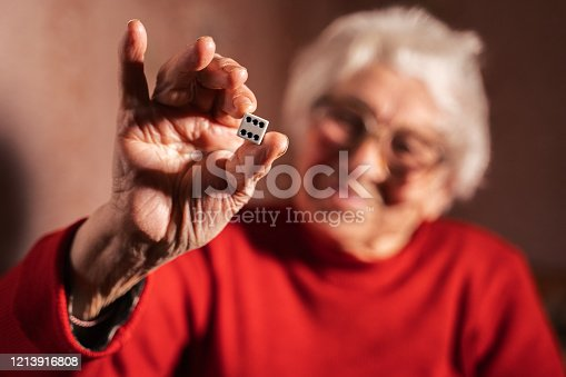 Fighting with cancer. Close-Up of A Person Holding dice and turning them around in the hand  while thinking.  Gambling. Games of chance.