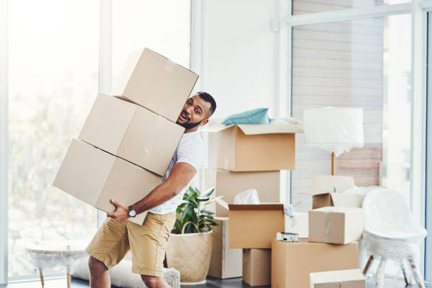 Luckily I have the muscles to carry all of these! stock photo