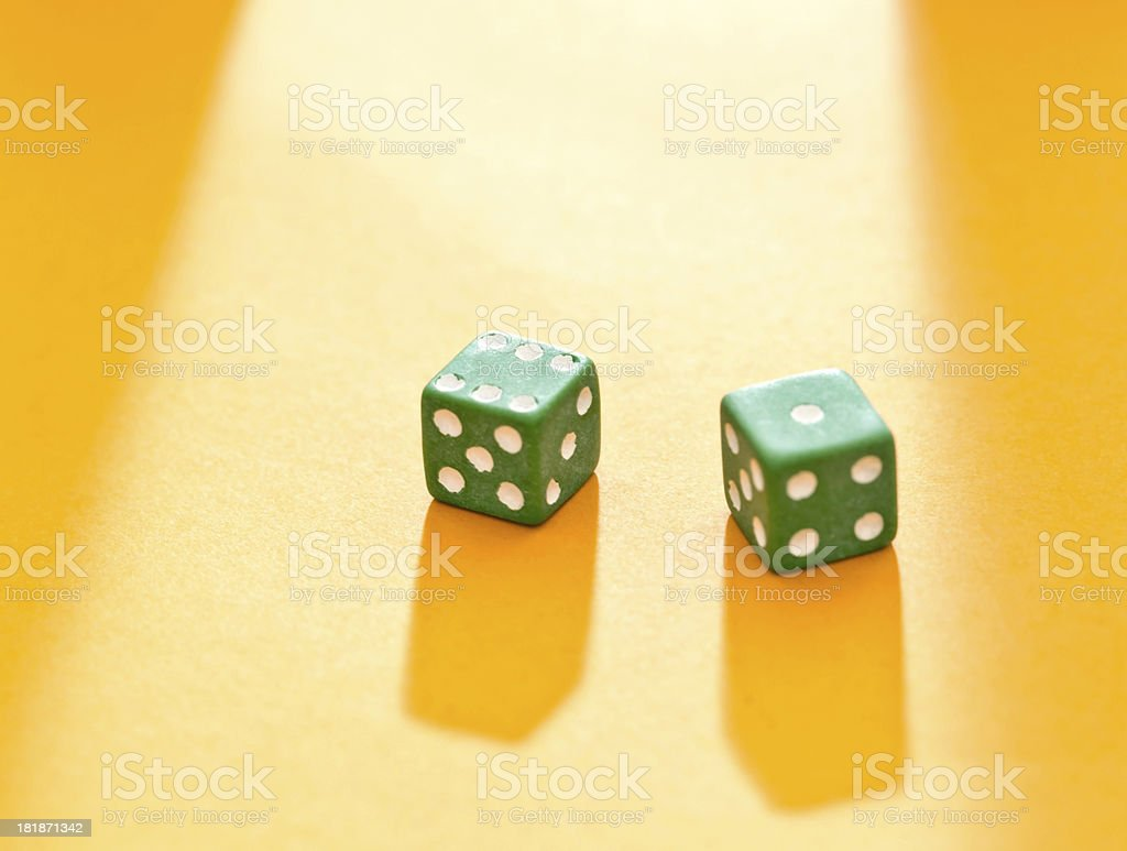 Lucky 7? Pair of dice on golden background royalty-free stock photo