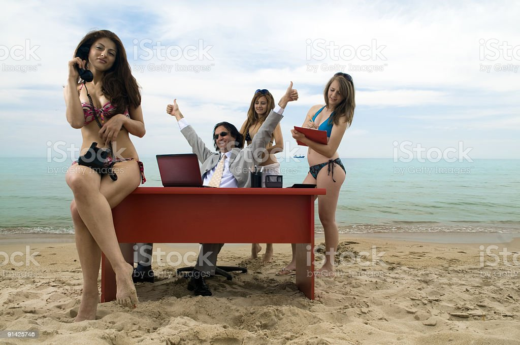 Lucky businessman in paradise royalty-free stock photo