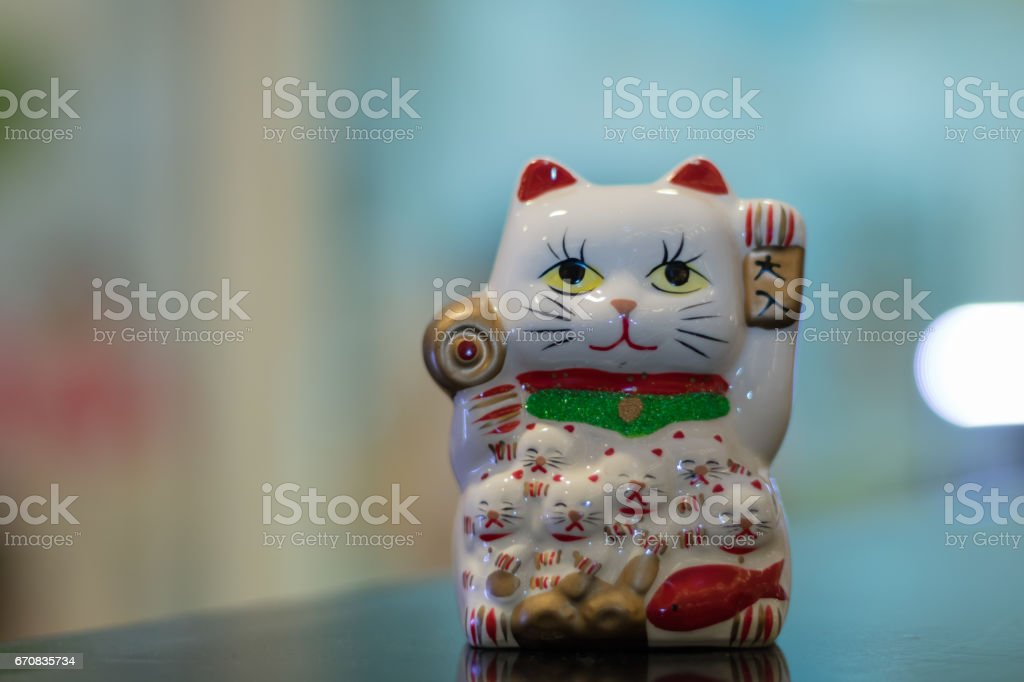 Lucky Cat in blurred background. stock photo
