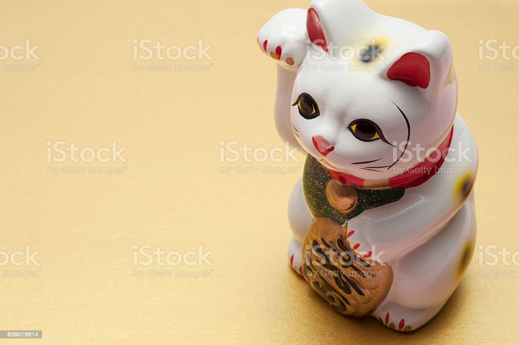lucky cat on gold background stock photo