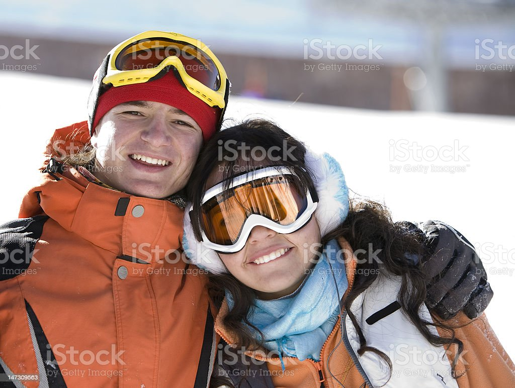 Lucky couple  snowboarders  in a mountain stock photo